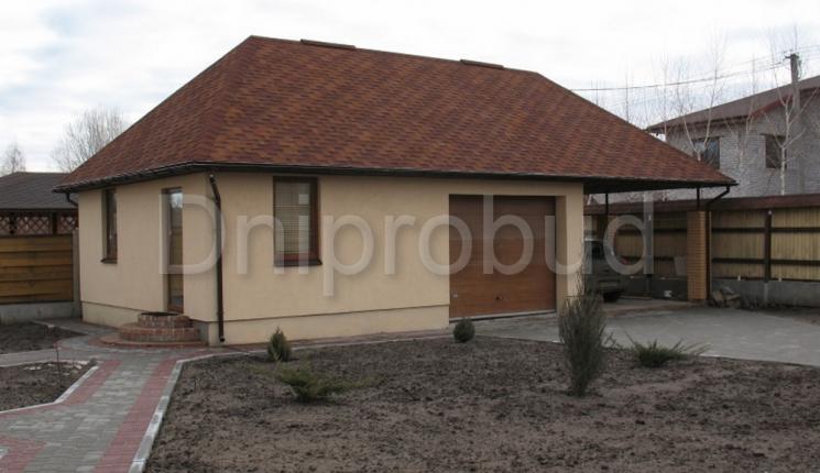 Гостьовий будинок з гаражем та навісом