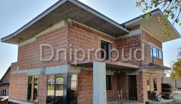 Будинок з плоскою покрівлею в сучасному стилі